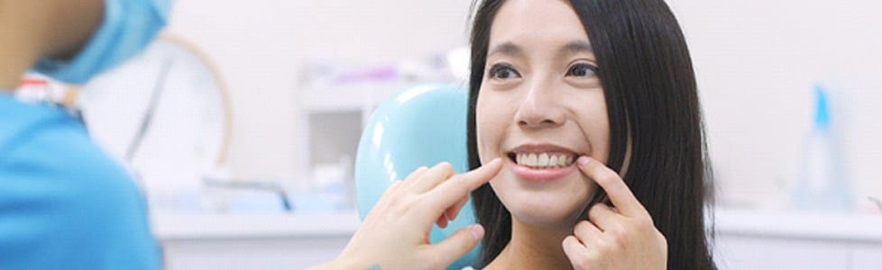 Smiling woman at dentist's