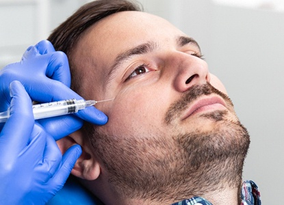 a person receiving BOTOX injections to address smile lines