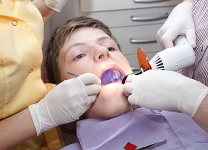 A young patient receiving a dental crown.